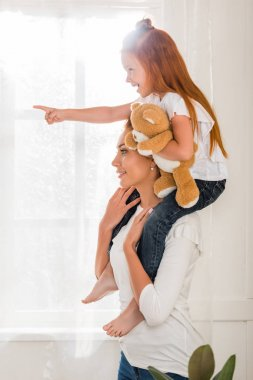 Mother and daughter piggybacking