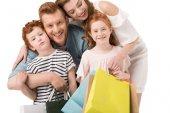 Fotografie Glückliche Familie mit Einkaufstüten