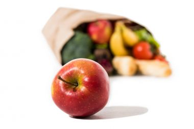 ripe apple and grocery bag