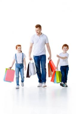 father with kids shopping together