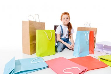 child with colorful shopping bags