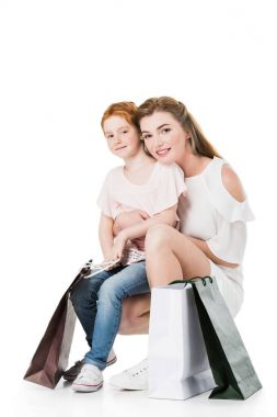 mother and daughter with shopping bags