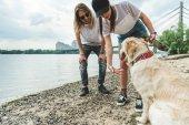 Fotografie junges paar mit hund