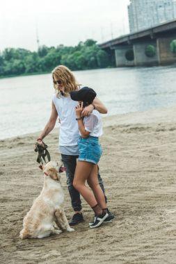 couple on walk with dog