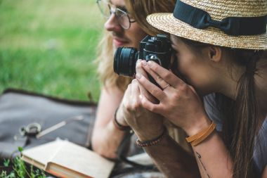 couple taking photos with vintage camera