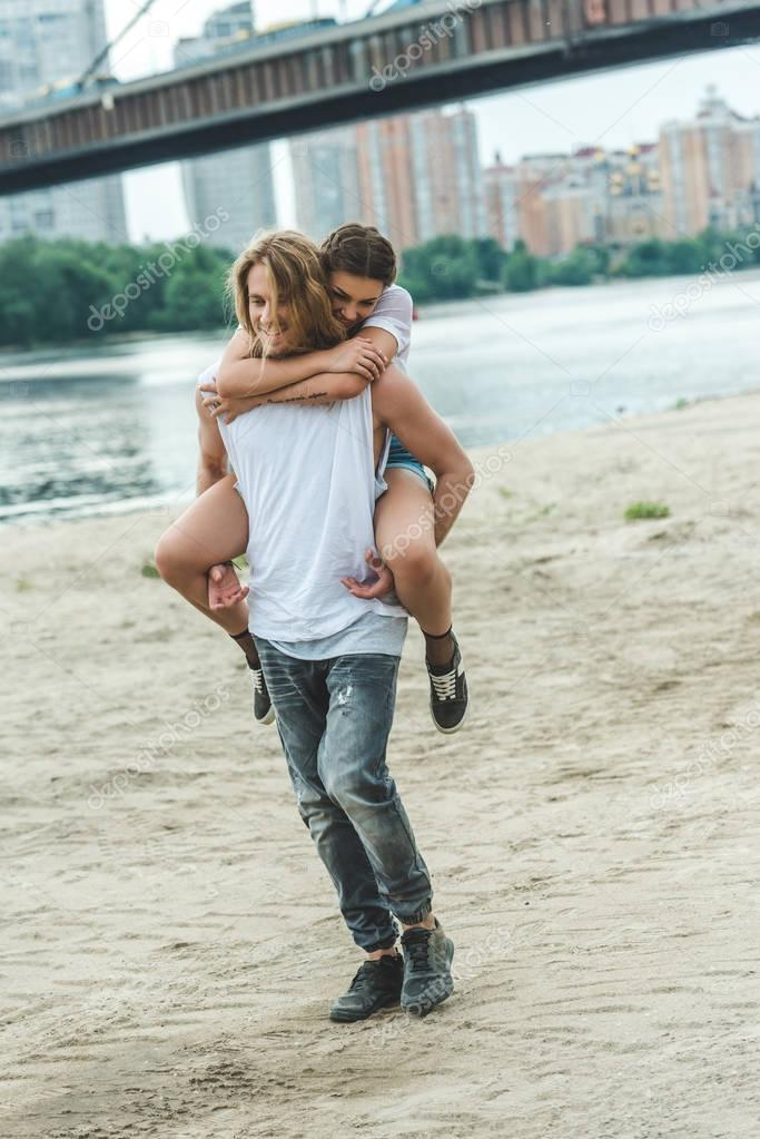 Woman piggybacking on boyfriend