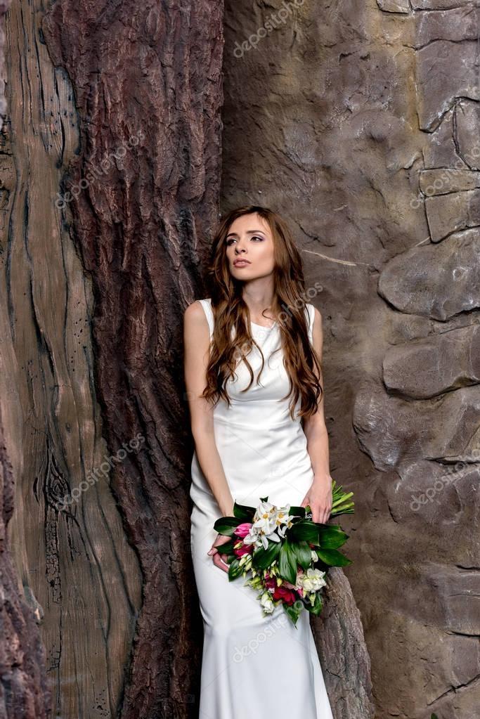 elegant bride with wedding bouquet