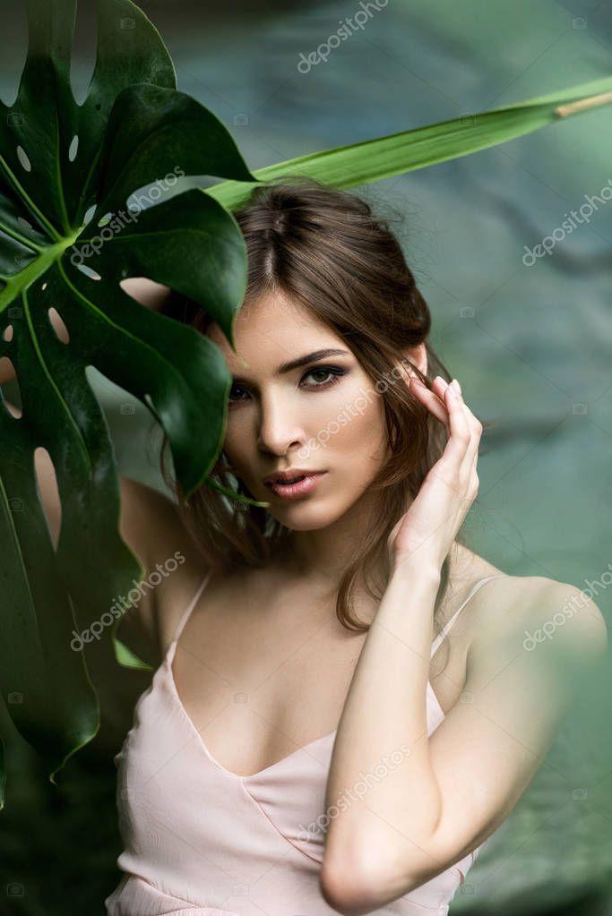 Beautiful woman with palm leaf
