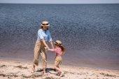 Fotografie mother and daughter at seashore