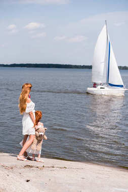 mother and daughter looking at yacht