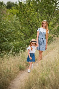 Mother and daughter walking on trail