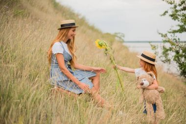 mother and daughter with sunflowers