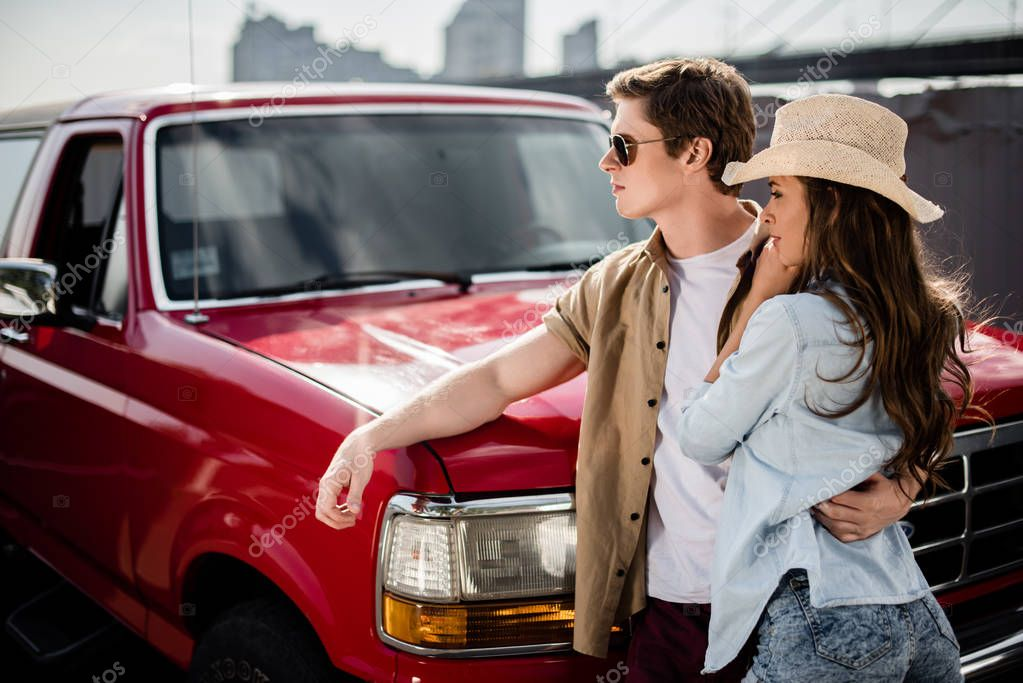 couple with classical car