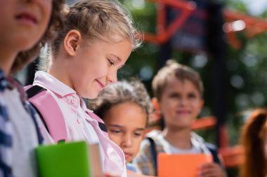 Kids with books on playground
