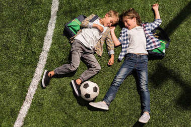 schoolboys with soccer ball