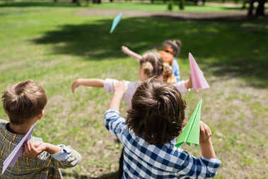 kids playing with paper planes