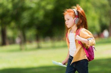 redhead schoolchild in headphones