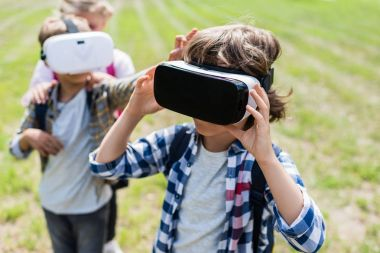 Kids using vr headsets