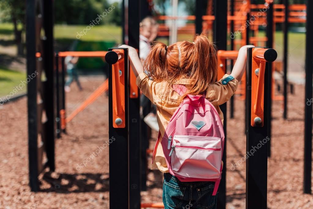 Redhead child on playground