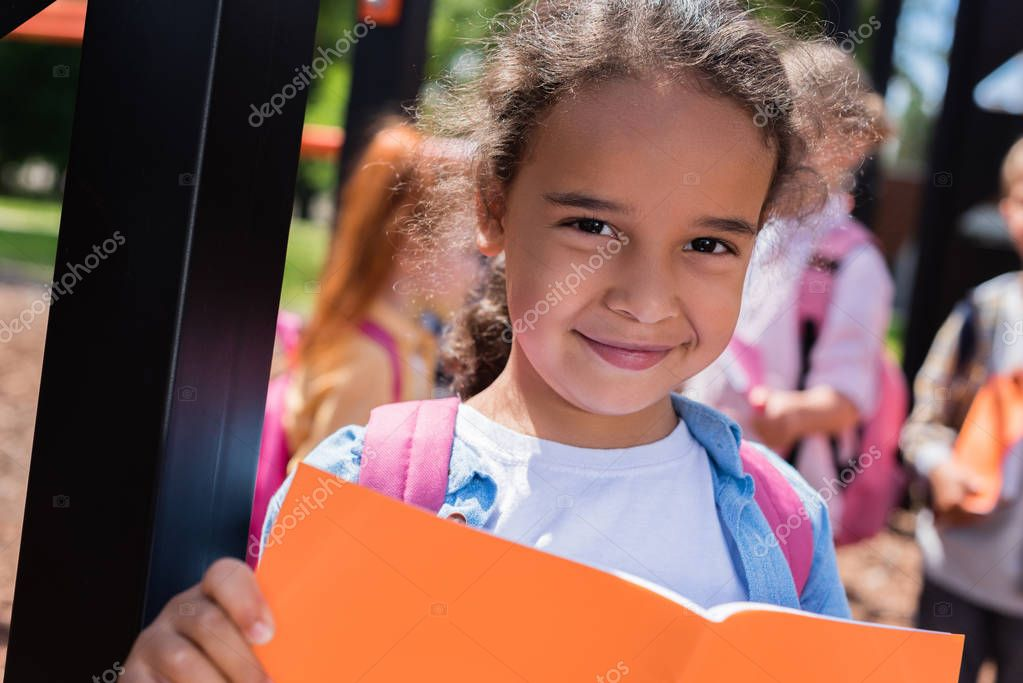 african american child with book