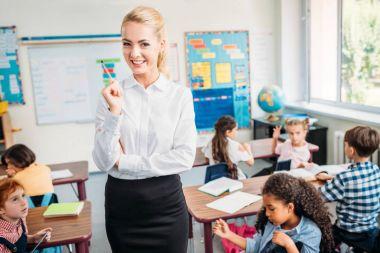 beautiful young teacher in class