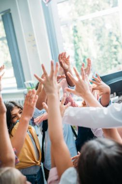 funny kids raising hands