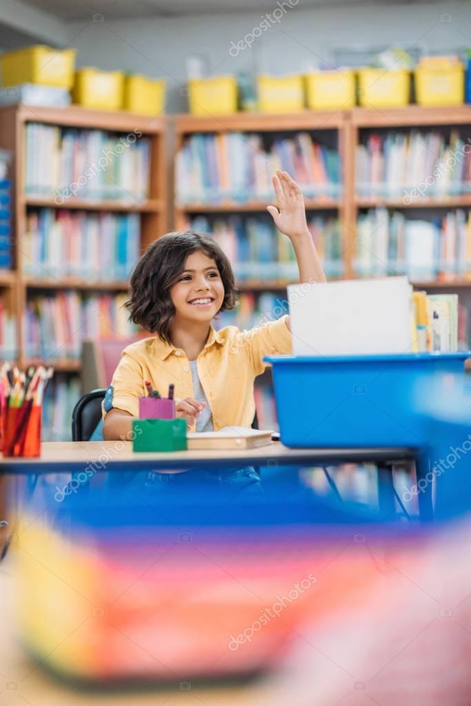 girl raising hand on lesson