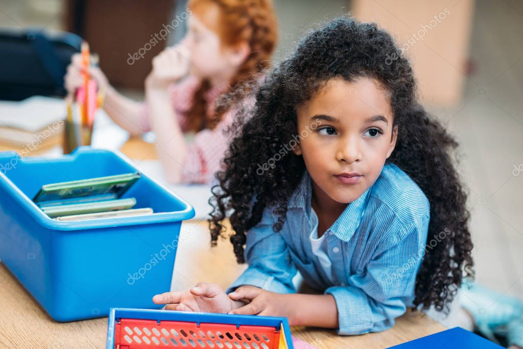 girl with box of books