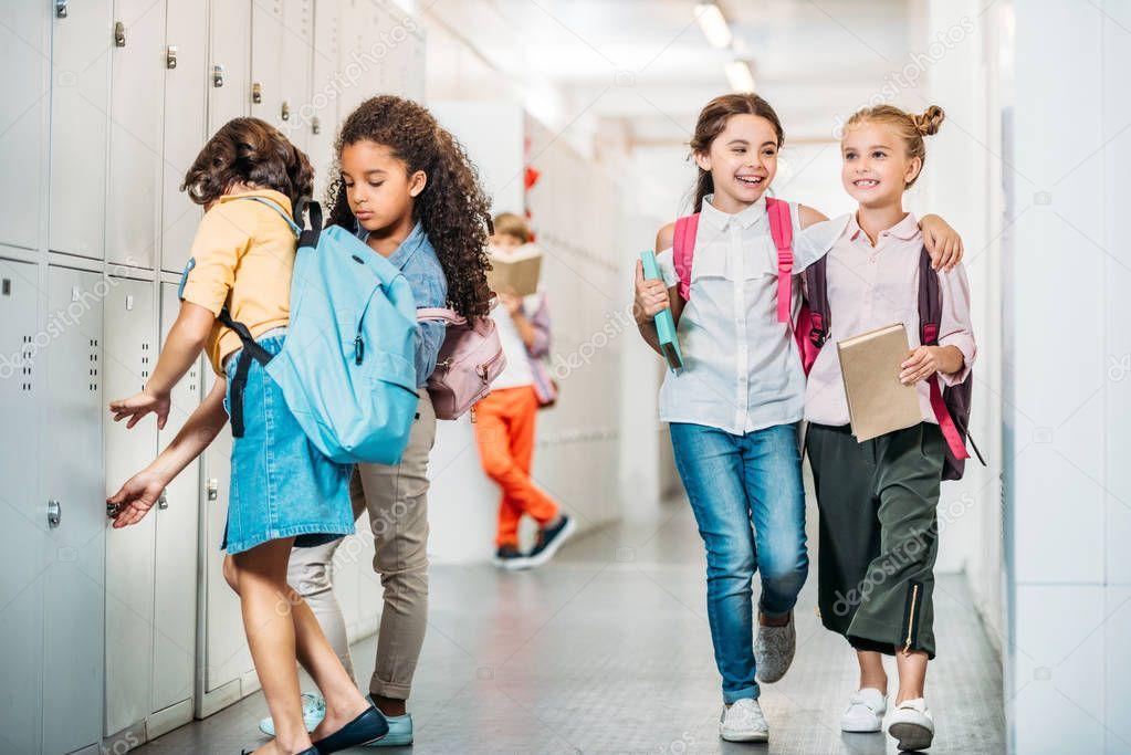 schoolgirls walking through school corridor