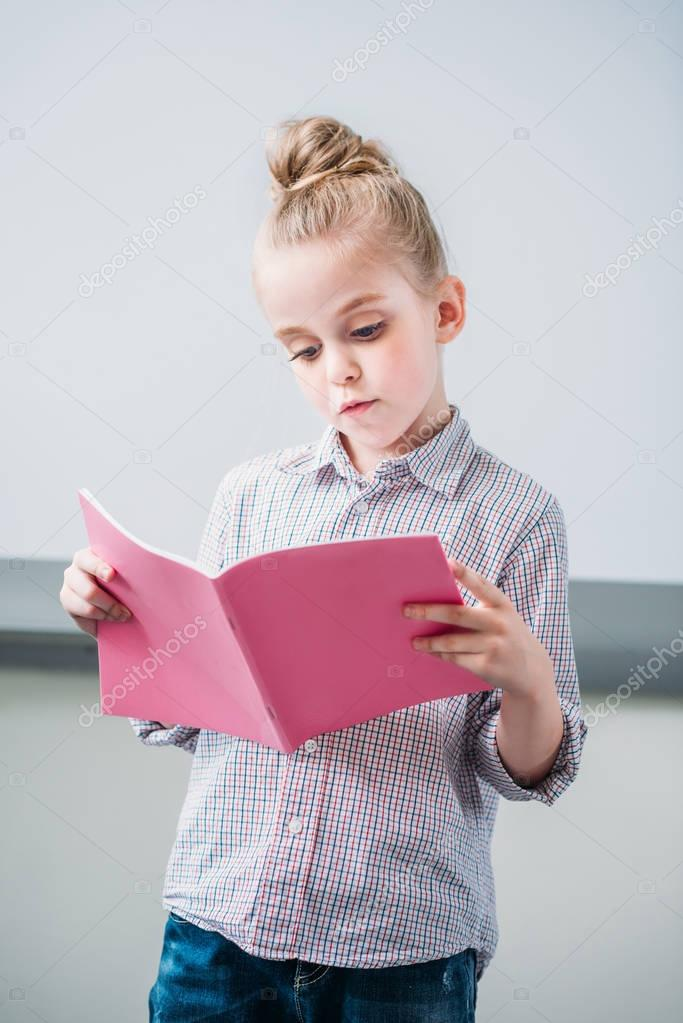 schoolgirl looking at notebook