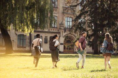students running to university