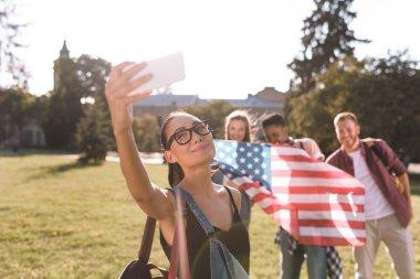 multicultural friends taking selfie