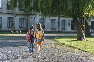 girls walking in university park