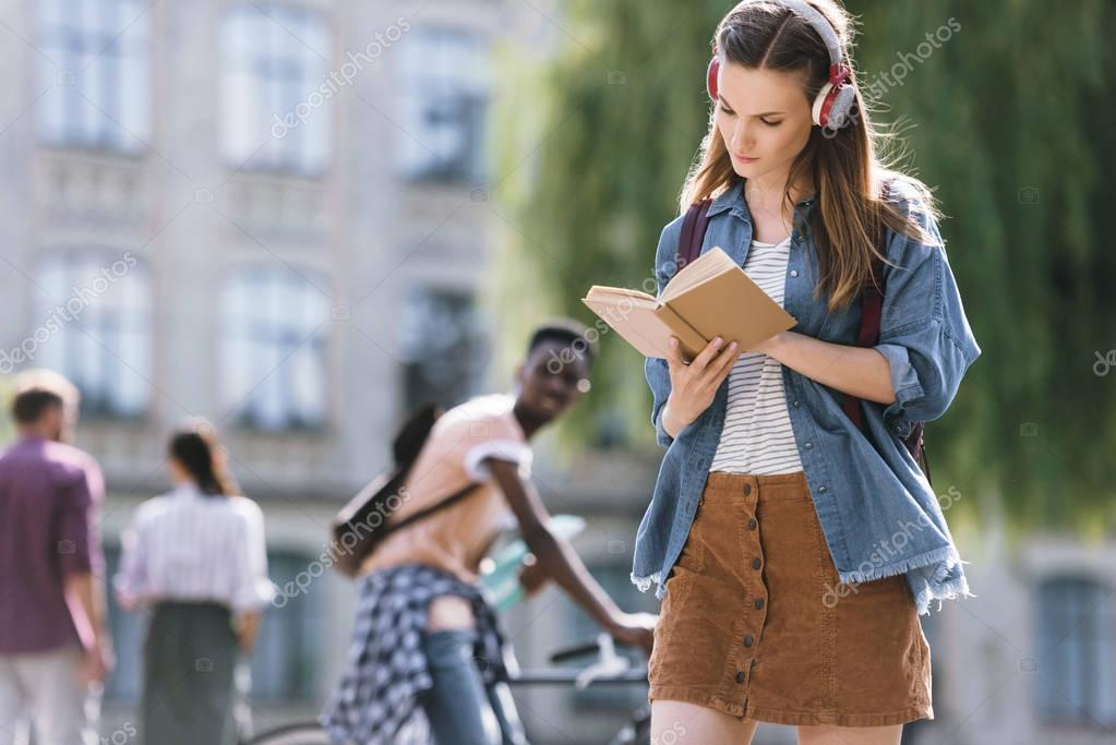 attractive student reading book