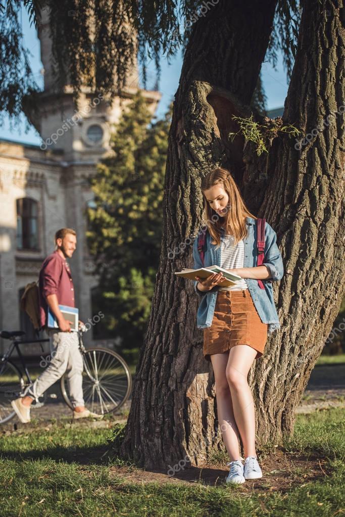 student girl reading homework
