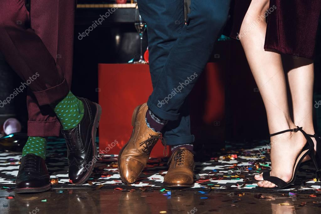 people standing on floor with confetti