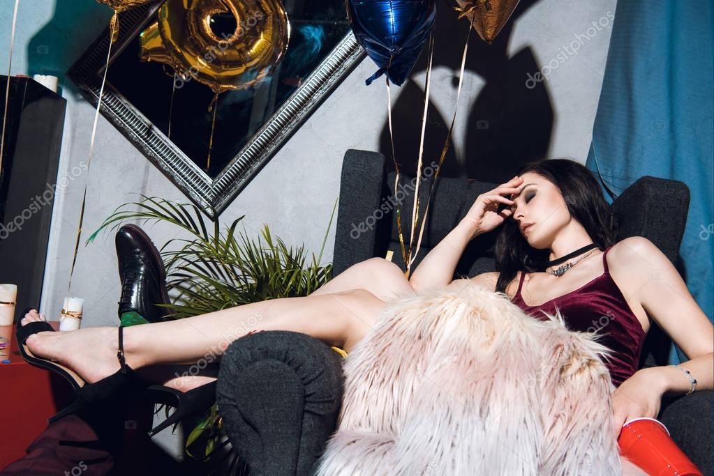 drunk woman sleeping in armchair