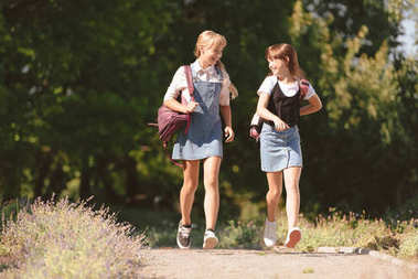 Teenagers walking in park