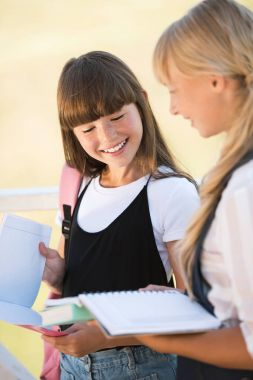 Smiling teenagers with books