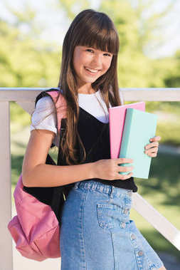 Smiling teenager with books