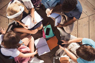 multiethnic teenagers studying together