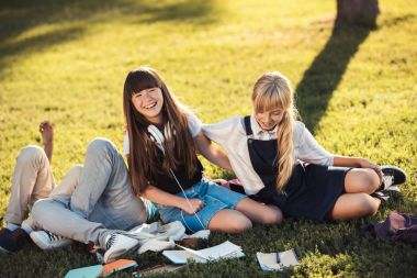 teenagers studying in park