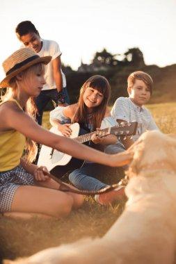 multiethnic teenagers with guitar