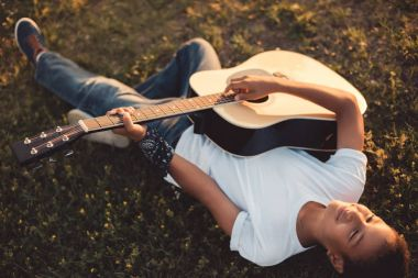 african american boy with guitar