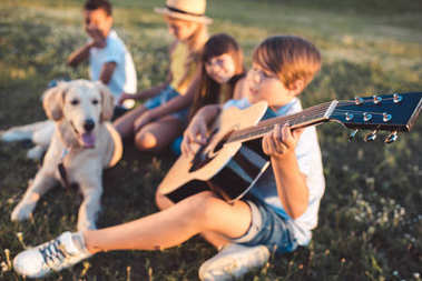 multiethnic teenagers with guitar