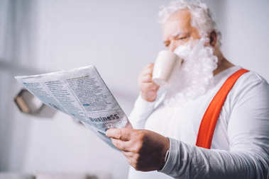 santa claus reading newspaper