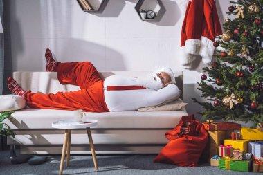santa claus resting on sofa