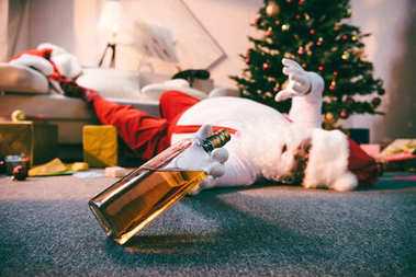 santa claus with bottle of whiskey