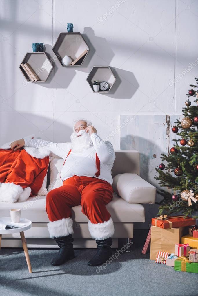 santa claus talking on smartphone