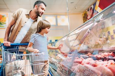 father with son in supermarket